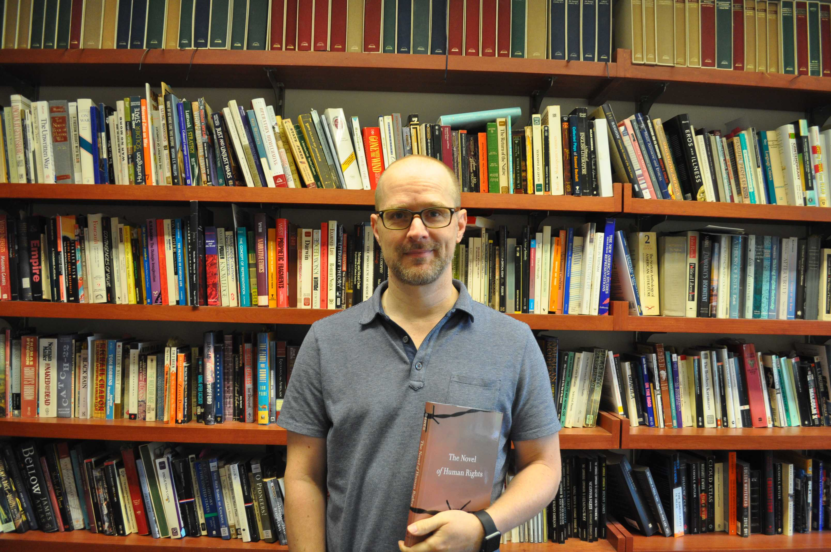 Professor Dawes poses with his new book. Photo by Malcolm Cooke '21.