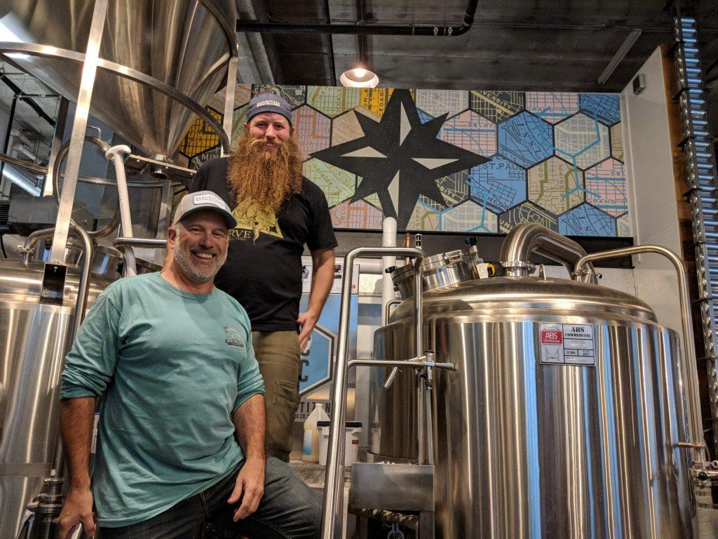 Head brewer Max Filter (top) with his father, Kevin Filter, a Macalester alum. Photo by Henry Nieberg '19.