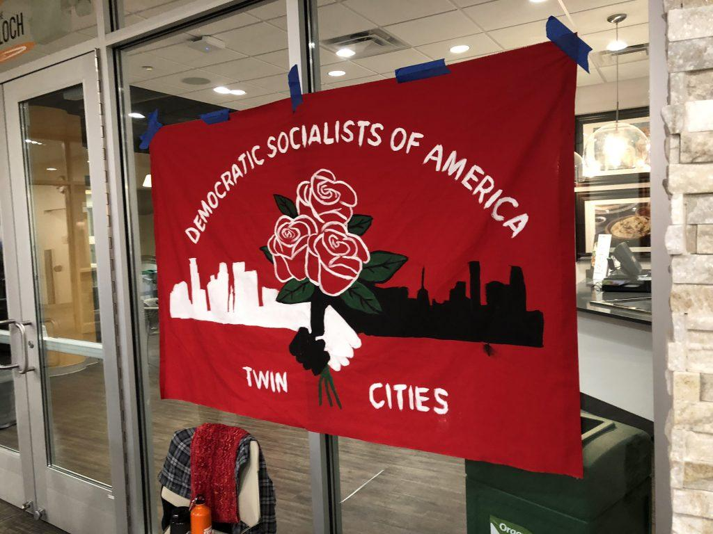 A+Twin+Cities+DSA+flag+hangs+outside+of+John+B.+Davis+Lecture+Hall.+Photo+by+Abe+Asher+%E2%80%9920.
