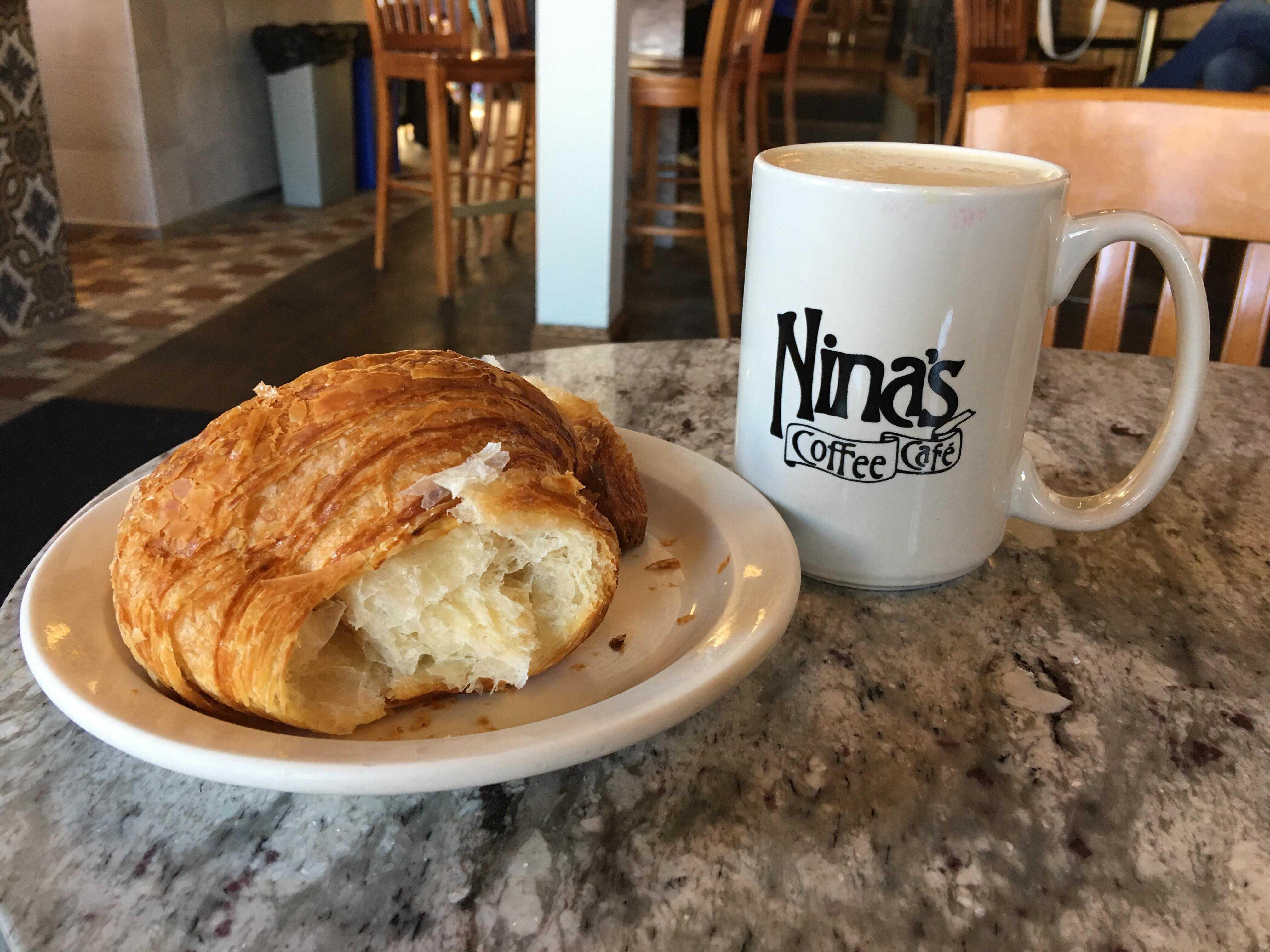 Croissant with a mug of Nina's Coffee. Photo by Anna Hestad '19.