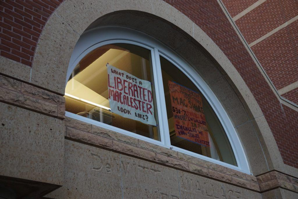A sign hanging in the window of The Link. Photo by Ally Kruper '21.