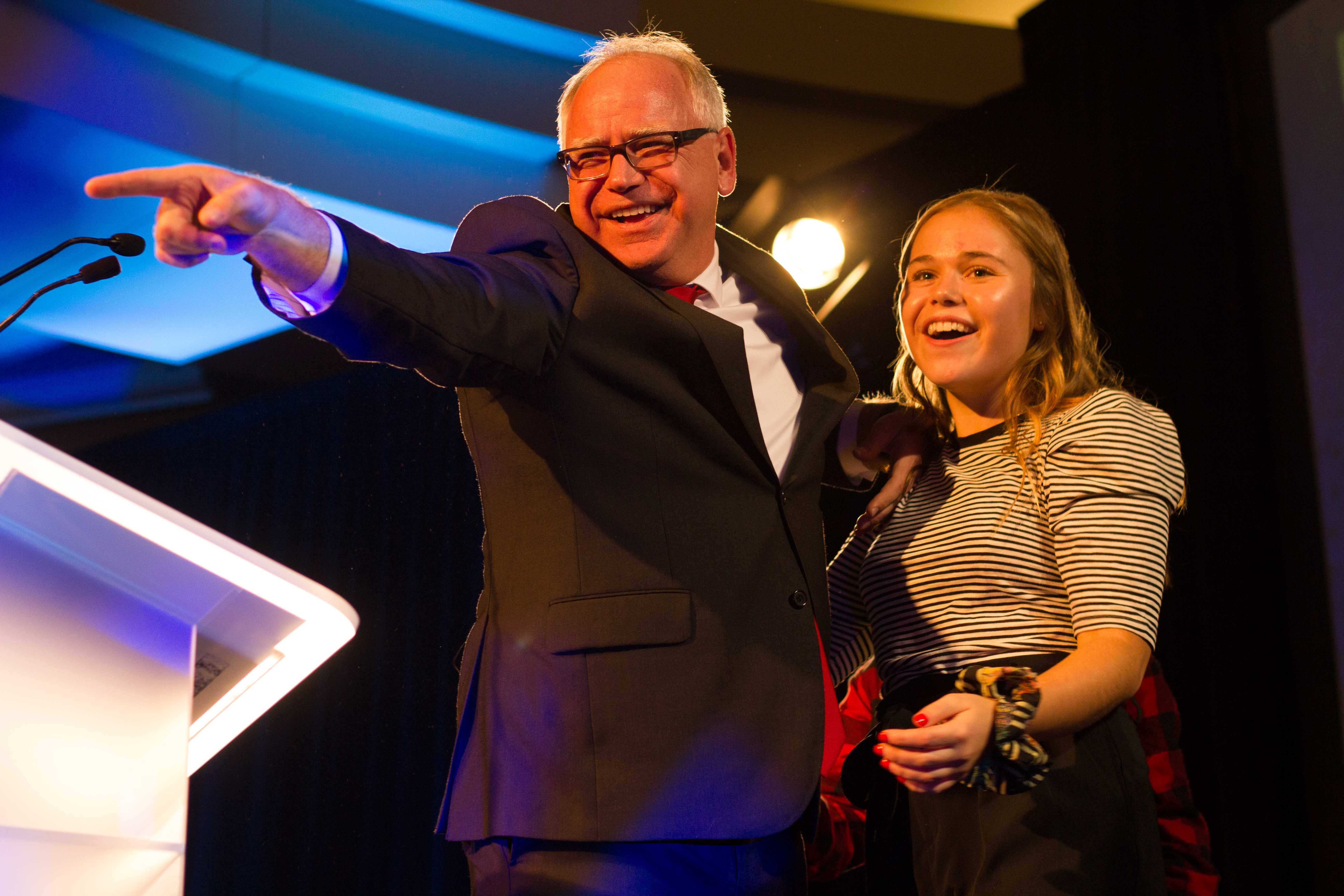 Governor-elect Rep. Tim Walz (D-MN) celebrates on stage with his daughter at the DFL election night party. Photo by Celia Johnson '22