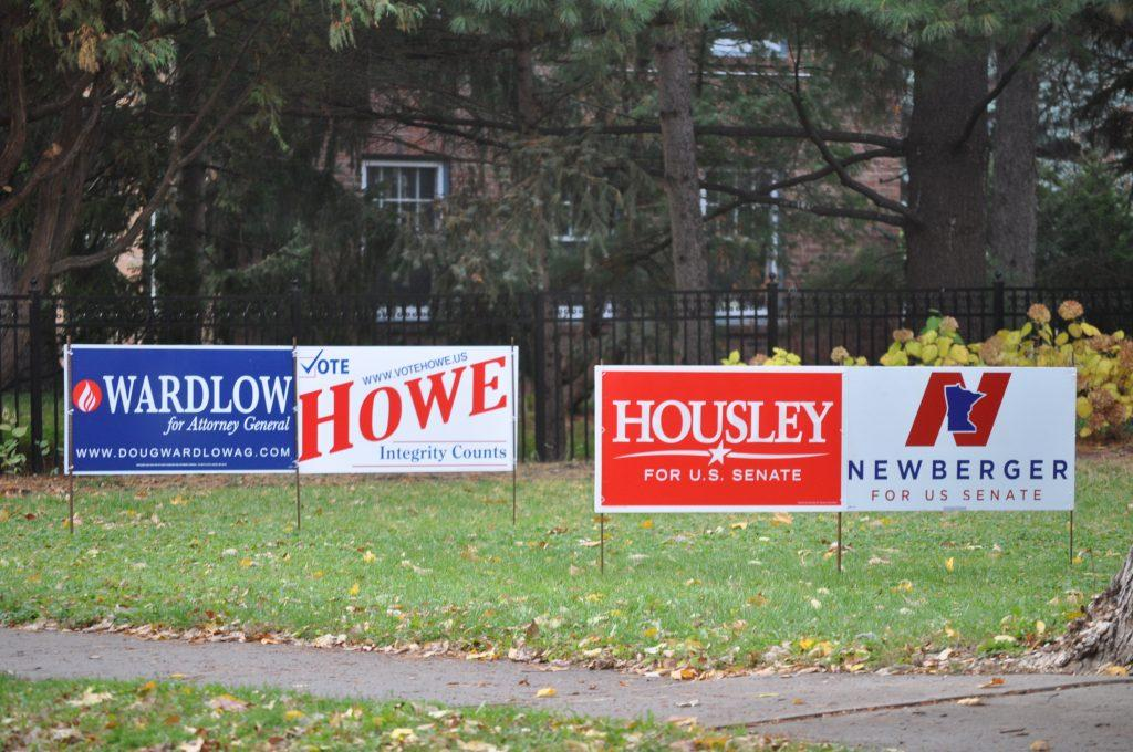 Campaign signs decorate the front lawn of a home on Summit Ave. Photo by Malcolm Cooke '21.