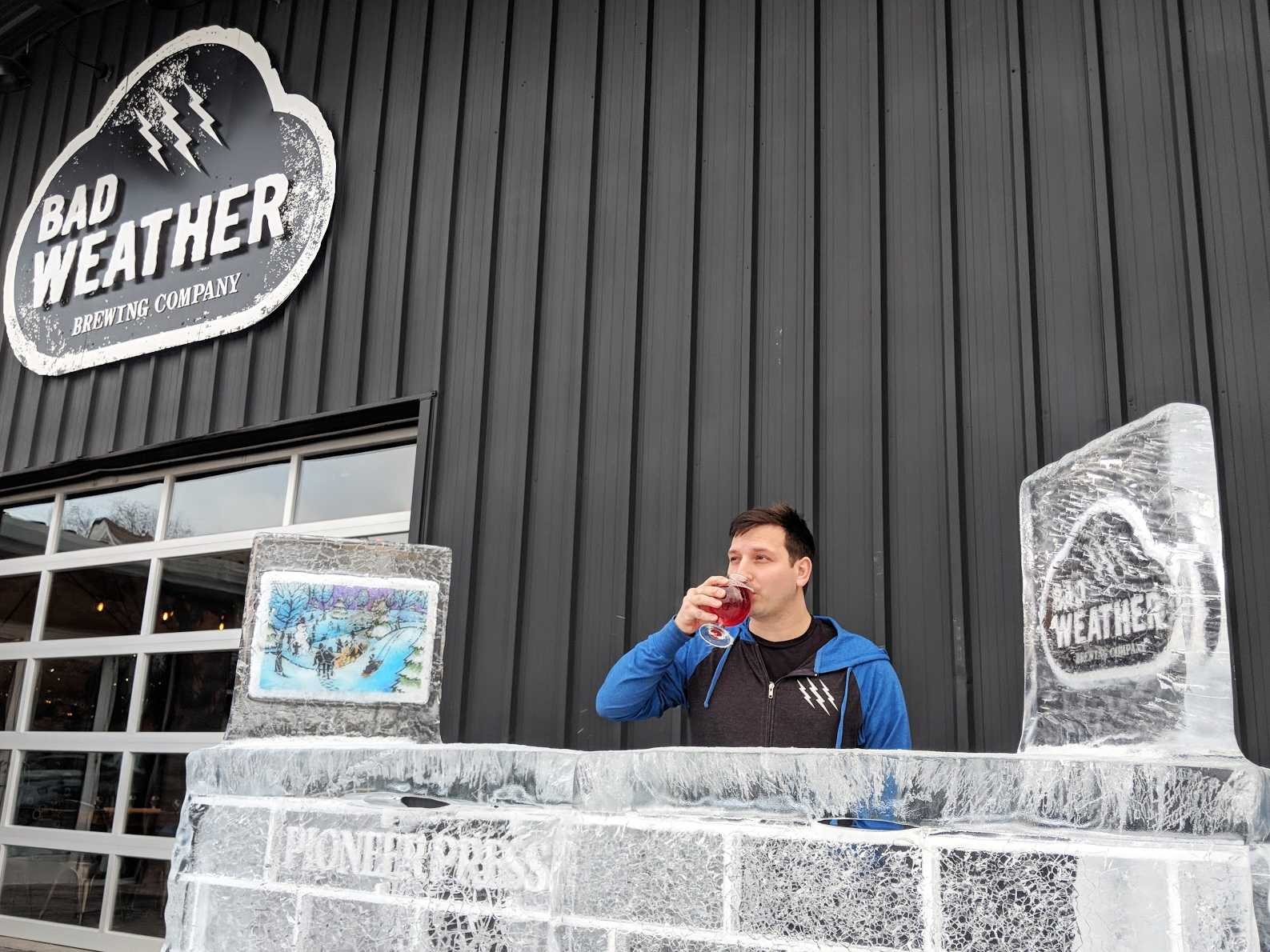 Joe Giambruno sips a craft brew outside Bad Weather Brewing Company. Photo courtesy of Henry Nieberg '19.