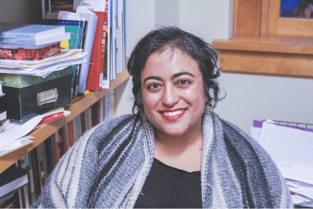 Political science professor Althea Sircar in her office. Photo by Rebecca Edwards '21.