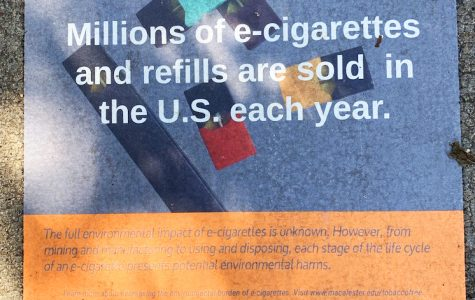Macalester's tobacco-free campaign lines campus walkways with signs. These and other efforst highlight the environmental impact of e-cigarettes. Photo by Bergen Schmidt '22.