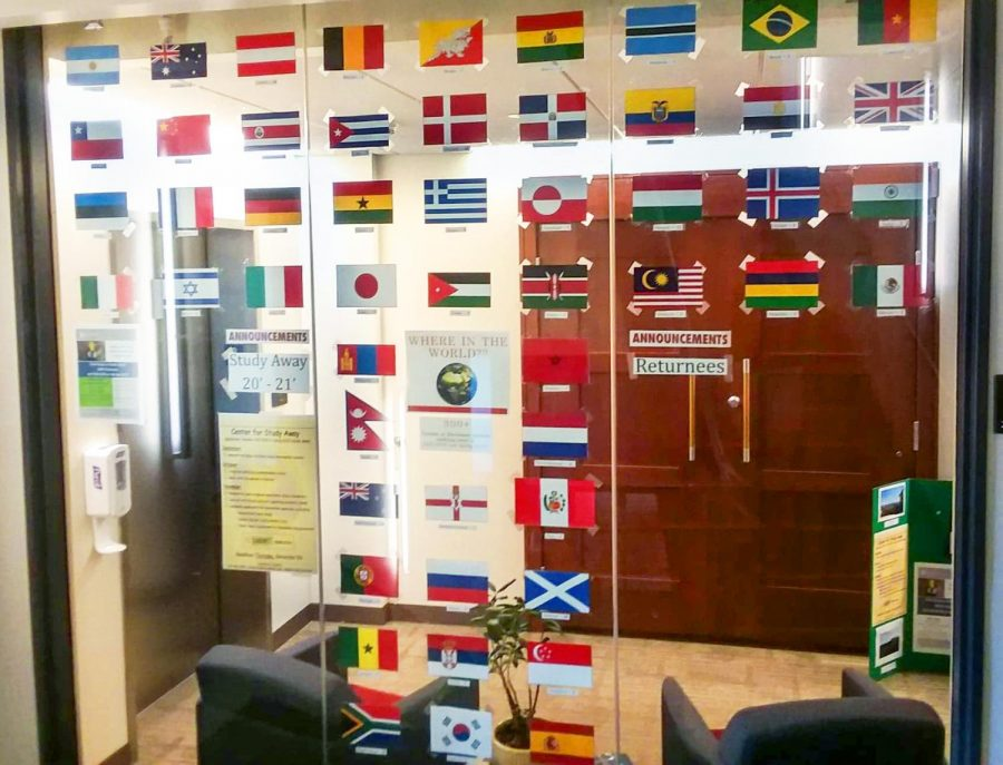 The+entrance+to+Center+for+Study+Away+displays+flags+of+countries+where+students+were+abroad.+Photo+by+Estelle+Timar-Wilcox+%E2%80%9922.