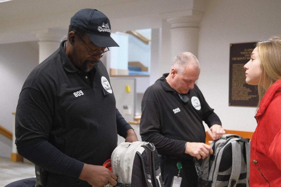 Guards from Asia Security perform a bag check at the Dewitt Wallace Library entrance. Photo by Kori Suzuki '21.