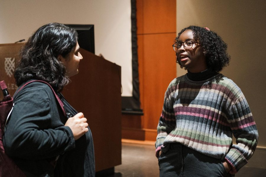 Isra+Hirsi+speaks+with+environmental+science+professor+Roopali+Phadke.+Photo+by+Kori+Suzuki+%E2%80%9921.