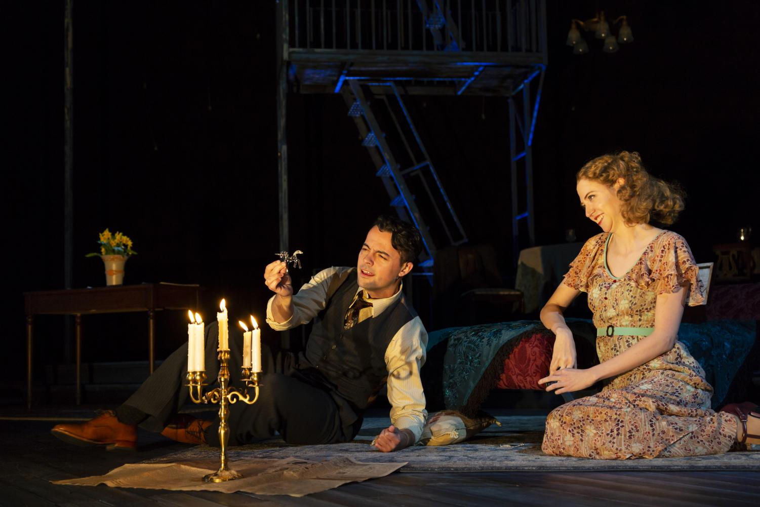 Jim (Grayson DeJesus) and Laura (Carey Cox) share an intimate scene by candlelight. Photo by T. Charles Erickson.
