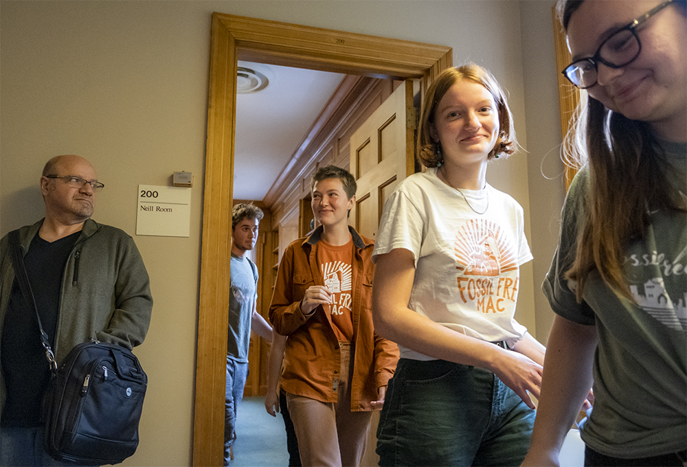 Members of Fossil Free Mac exit a conference room after meeting with Board of Trustees members following the Board's October meeting. Photo by Kori Suzuki '21.