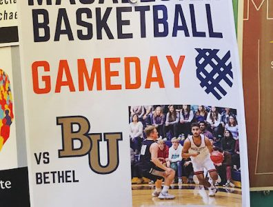 The Macalester basketball team hangs flyers around campus to advertise for games like this one as part of their ongoing effort to increase attendance. Photo by Talia Bank '23.