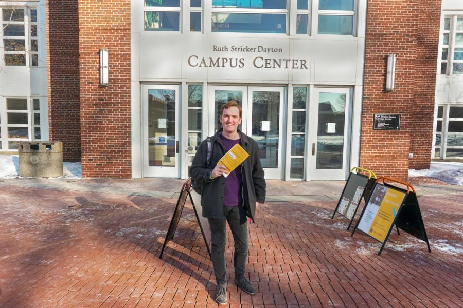 Brian White '21 with his absentee ballot in front of the Campus Center. Photo by Smith Mayse '22.