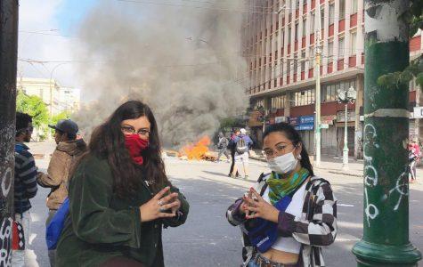 Gabi Estrada '21  and Tori Gapuz '21 at a nationwide general strike on Nov. 12, at Plaza Victoria. Photo courtesy of Gapuz.