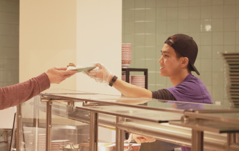 Cafe Mac student worker serves food. Photo by Shosuke Noma '23.