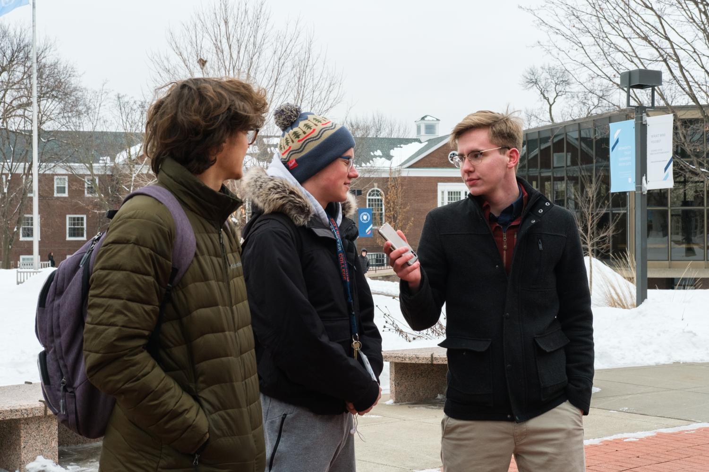 Hooten interviews students in front of the CC. Photo by Kori Suzuki '21