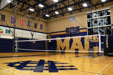 The volleyball net in the Alumni Gymnasium. Photo by Celia Johnson '22.