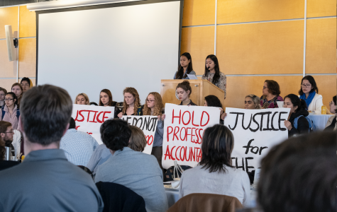 Blair Cha '20, surrounded by student supporters, addresses faculty assembled in the Alexander G. Kagin Ballroom on Tuesday afternoon. Photo by Kori Suzuki '21.