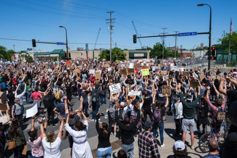 Hundreds of protesters show solidarity for George Floyd on the corner of Nicollet Ave and E 31st St. Photo by Kori Suzuki
