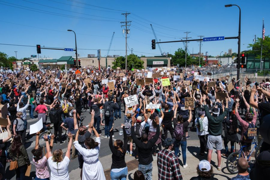Hundreds of protesters show solidarity for George Floyd on the corner of Nicollet Ave and E 31st St. Photo by Kori Suzuki '21.