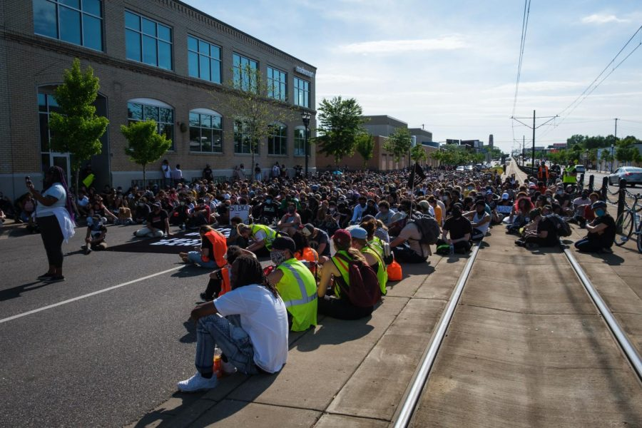 On May 31, 2020, peaceful protests against the Minneapolis police killing of George Floyd continued as more than a thousand protesters marched along I-94 and University Ave in Saint Paul. Photos by Kori Suzuki '21.