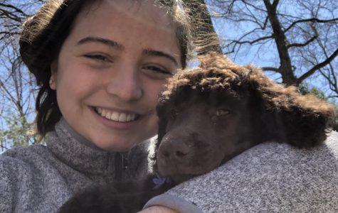 Lily Cooper '23 with new puppy Otis. Photo courtesy of Cooper.