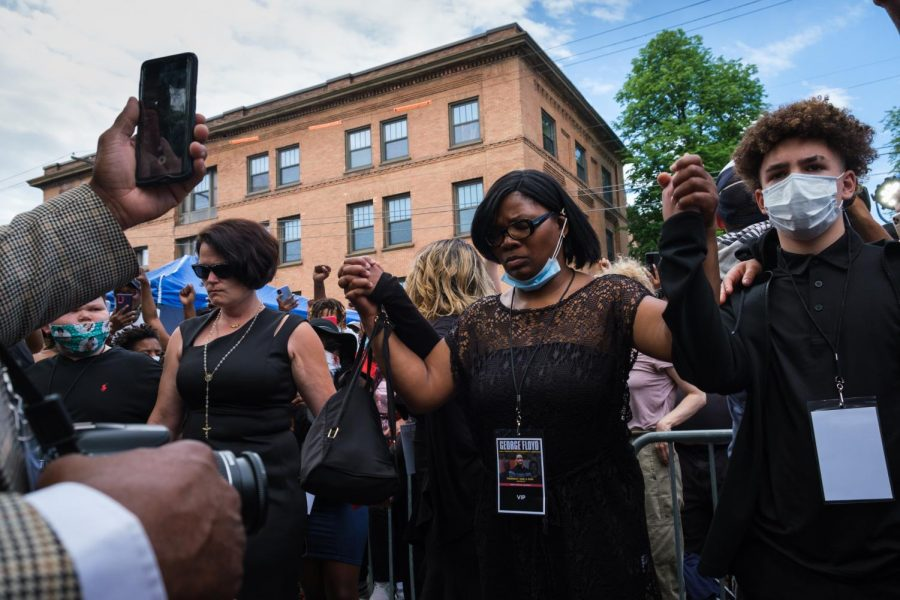 "Hundreds gathered outside North Central University in Minneapolis Thursday afternoon as family and friends of George Floyd held a memorial inside. As they left the chapel, Mel Reeves, Toshira Garraway and a number of local activists turned and spoke to the crowd. ""We are going to keep him alive,"" Reeves said. ""We plan on making this system choke on the name of George Floyd.""  Photos by Kori Suzuki"