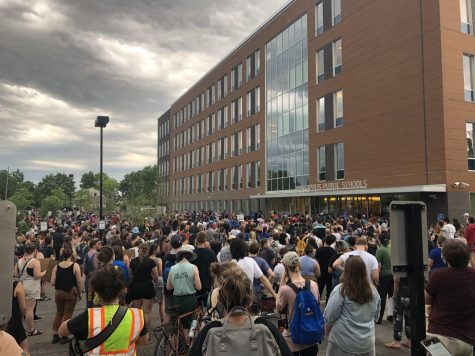 Demonstrators gather around the Minneapolis Public Schools building on June 2nd to encourage the school board to cut ties with the Minneapolis Police Department. Photo by Abe Asher