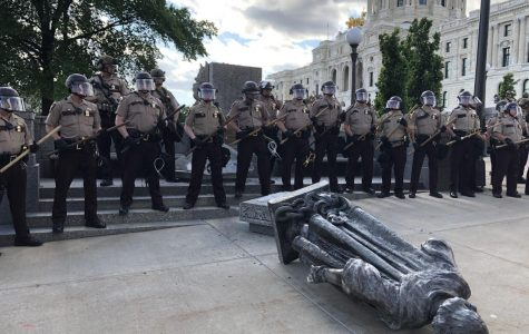 State troops guard the fallen statue of Christopher Columbus, which was toppled by Indigenous activists on June 10th. Photo by Abe Asher '20.