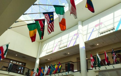 Flags hanging in the campus center. Photo by Hannah Catlin '21.