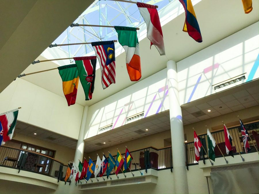 Flags hanging in the campus center. Photo by Hannah Catlin