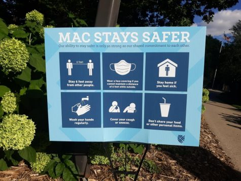 "New ""Mac Stays Safer"" signs with social distancing guidelines are posted around campus in preparation for some students to arrive this fall. Photo by Estelle Timar-Wilcox '22."