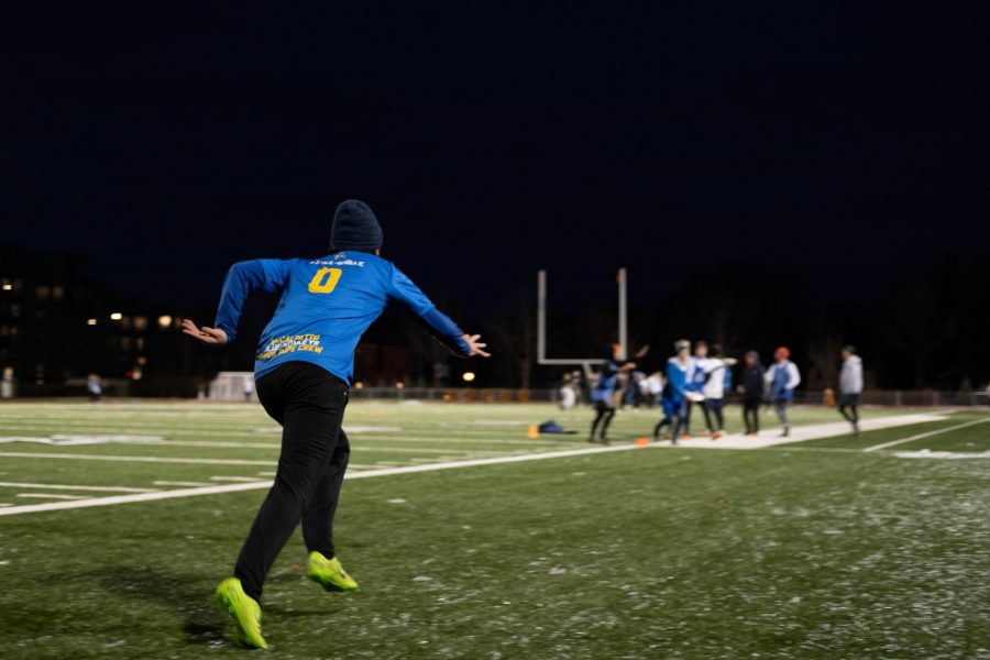 The Blue Monkeys practice on the football field. Photo by Kori Suzuki