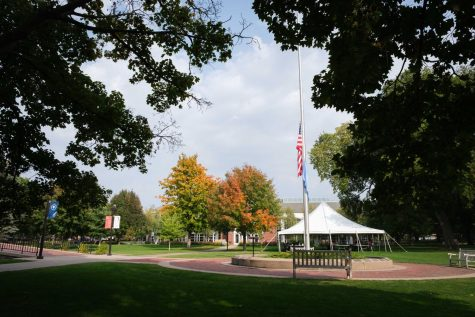 The US and UN flag on Old Main Lawn at half-mast. Photo by Kori Suzuki