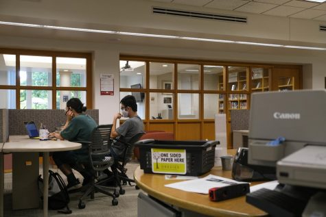 Students work in the library at the end of the quiet period. Photo by Malcolm Cooke