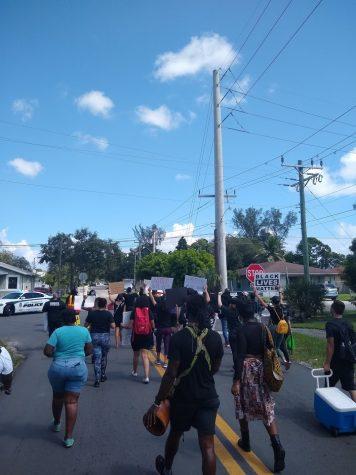 Protesters march against Ron DeSantis
