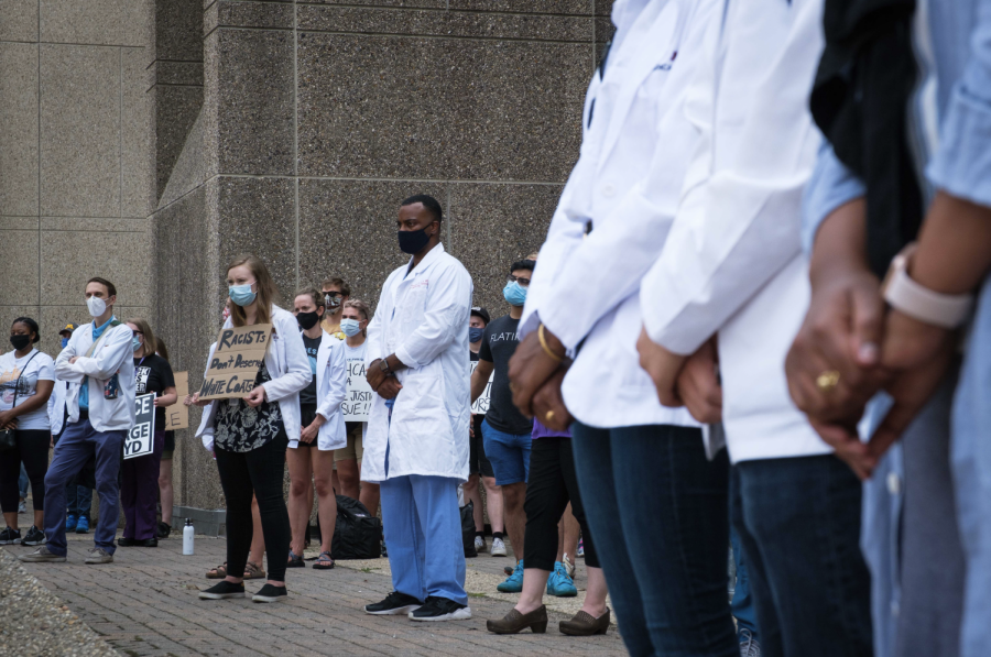 Medical students at the University of Minnesota hold a protest to speak out against former classmate Daniel Michelson, who was caught defacing the mural at the George Floyd Memorial, on August 27, 2020. Photo by Kori Suzuki '21.