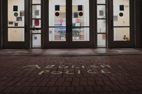 Chalk writing outside of the campus center calling for police abolition. Photo by Shosuke Noma '23.