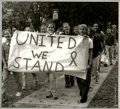 Excerpt from the Mac Weekly Sept. 21, 2001 issue. The original caption reads, Macalester athletes and other students participate in a march to show support for victims of last weeks tragedy, including people of Middle Eastern descent who have been targeted. Courtesy of the Macalester Archives.
